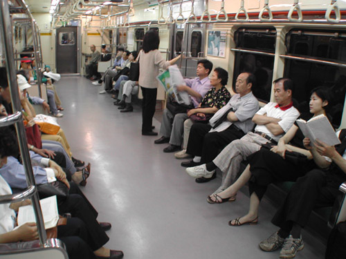 Passengers on a Subway car