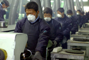 migrant workers working in a Korean factory